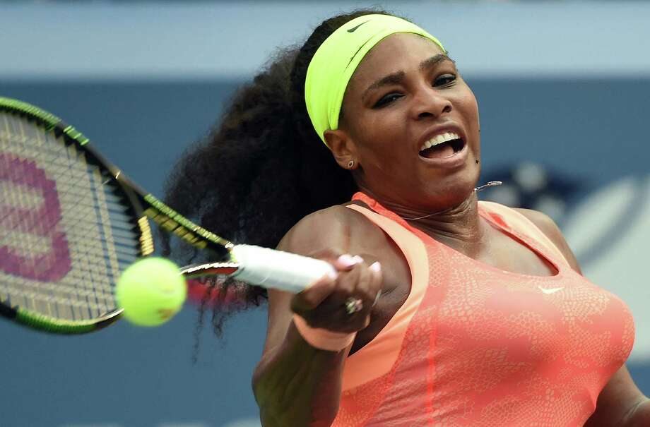 Serena Williams of the US returns to Kiki Bertens of the Netherlands during their 2015 US Open Women's singles round 2 match at USTA Billie Jean King National Tennis Center in New York on September 2, 2015. AFP PHOTO/JEWEL SAMADJEWEL SAMAD/AFP/Getty Images Photo: JEWEL SAMAD, Staff / AFP