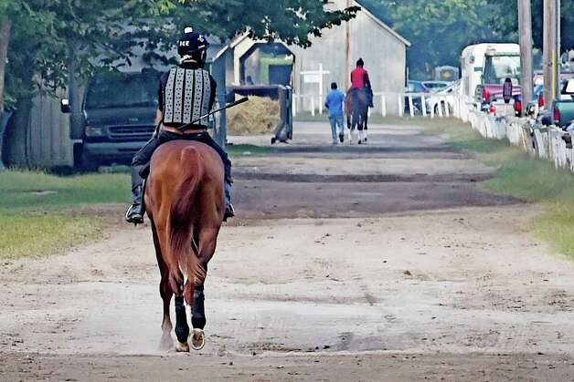 Horses go out for training on the Horse Haven walkway at the Oklahoma Training Center Wednesday Sept. 2, 2015  in Saratoga Springs, N.Y.    (Skip Dickstein/Times Union) Photo: SKIP DICKSTEIN