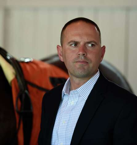 Trainer Chad Brown looks pensive after saddling a horse for the 8th race on the card Wednesday afternoon Sept. 2, 2015 at the Saratoga Race Course in Saratoga Springs, N.Y.    (Skip Dickstein/Times Union) Photo: SKIP DICKSTEIN