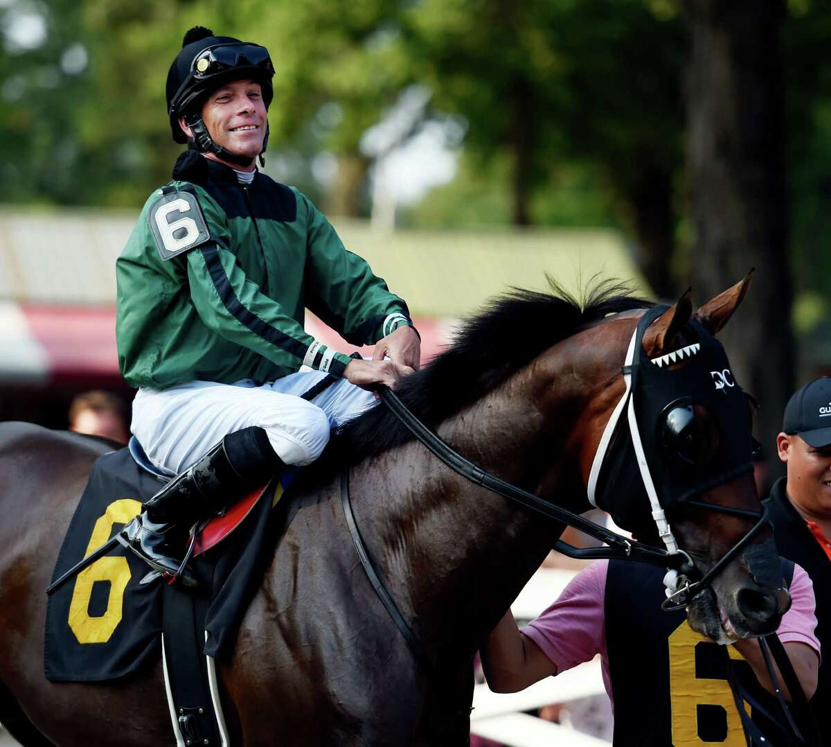 Jockey Mike Luzzi is all smiles as he makes his first start, since he sustained serious injuries when a horse fell on him at Aqueduct in November of 2014, Wednesday afternoon Sept. 2, 2015 at the Saratoga Race Course in Saratoga Springs, N.Y. (Skip Dickstein/Times Union)