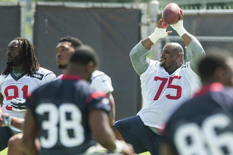 With many of his teammates sweating out roster spots, new Texans nose tackle Vince Wilfork (75) can relax while stretching, knowing that he's a lock. Photo: Brett Coomer, Staff / © 2015 Houston Chronicle