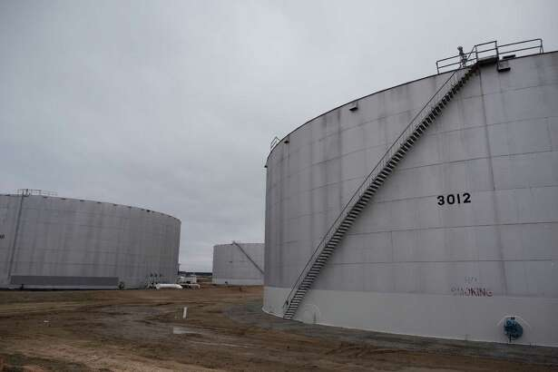 U.S. oil stored at the pipeline hub in Cushing, Okla., above, and elsewhere reached 487 million barrels last week, the seventh consecutive weekly gain.