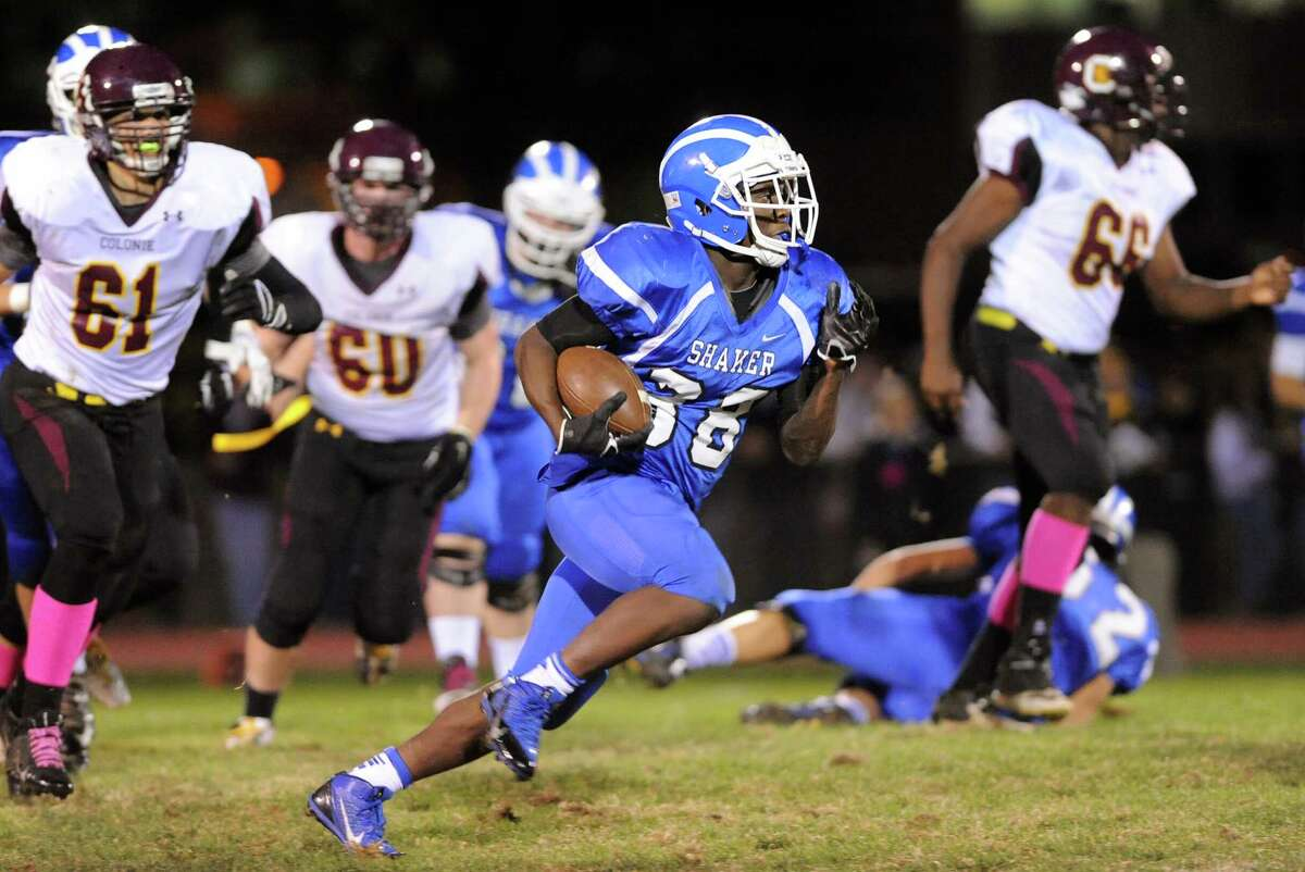 Shaker's Andrew Bolton, center, gains yards during their football game against Colonie on Friday, Oct. 17, 2014, at Shaker High in Latham, N.Y. (Cindy Schultz / Times Union)