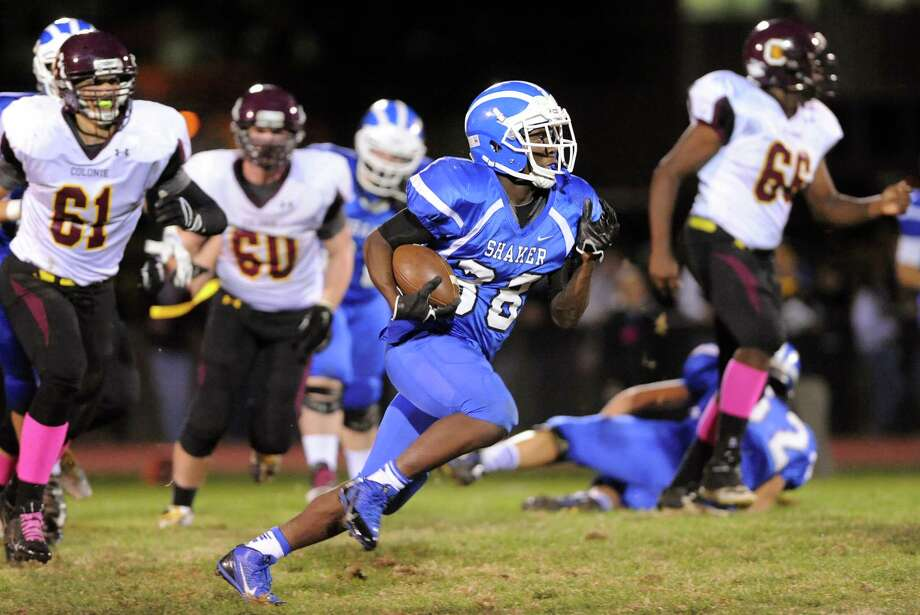 Shaker's Andrew Bolton, center, gains yards during their football game against Colonie on Friday, Oct. 17, 2014, at Shaker High in Latham, N.Y. (Cindy Schultz / Times Union) Photo: Cindy Schultz / 00029059A