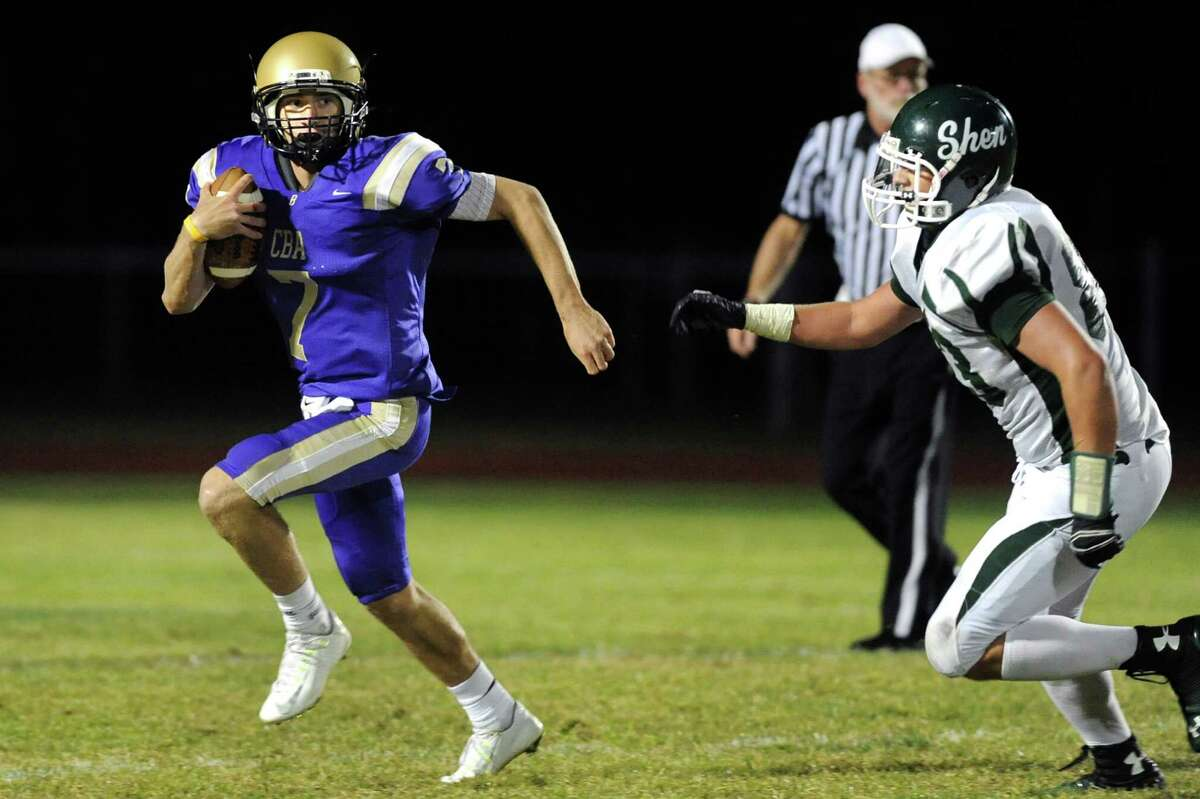 CBA's quarterback Joe Kolbe, left, gets pressure from Shen's Michael Gillooley during their football game on Friday, Sept. 19, 2014, at Christian Brothers Academy in Colonie, N.Y. (Cindy Schultz / Times Union)