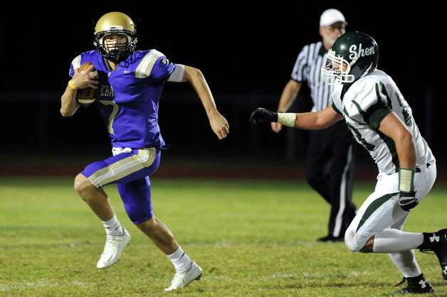 CBA's quarterback Joe Kolbe, left, gets pressure from Shen's Michael Gillooley during their football game on Friday, Sept. 19, 2014, at Christian Brothers Academy in Colonie, N.Y. (Cindy Schultz / Times Union) Photo: Cindy Schultz / 00028643A