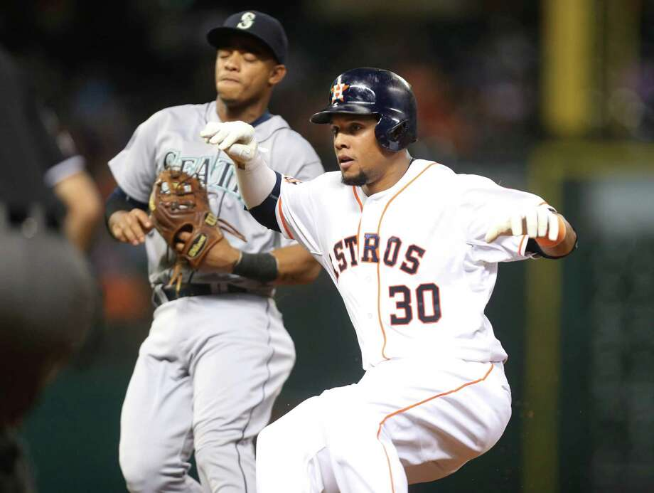 A sloppy game by the Astros on Wednesday included poor relief pitching, shaky fielding, a lack of timely hitting and a base-running blunder by Carlos Gomez, who was picked off in the fourth inning and tagged out by the Mariners' Taijuan Walker, left. Photo: Gary Coronado, Staff / © 2015 Houston Chronicle