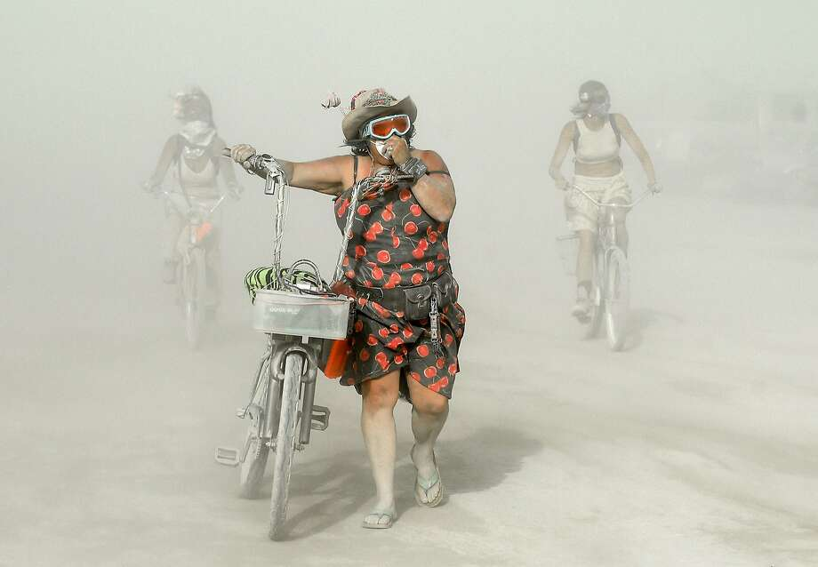 Participants make their way through dust at Burning Man in the Black Rock Desert of Nevada on Wednesday, Sept. 2, 2015. The 29th annual alternative living event is traditionally centered around the ritual burning of a large wooden effigy. Photo: Andy Barron, Associated Press