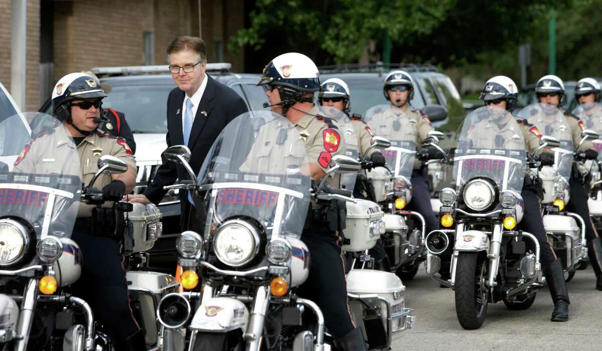 Texas Lieutenant Governor Dan Patrick talks with Montgomery County Sheriff's Motorcyle officers after a service for law enforcement at First Baptist Church of Conroe, 600 North Main St., Wednesday, Sept. 2, 2015, in Conroe.