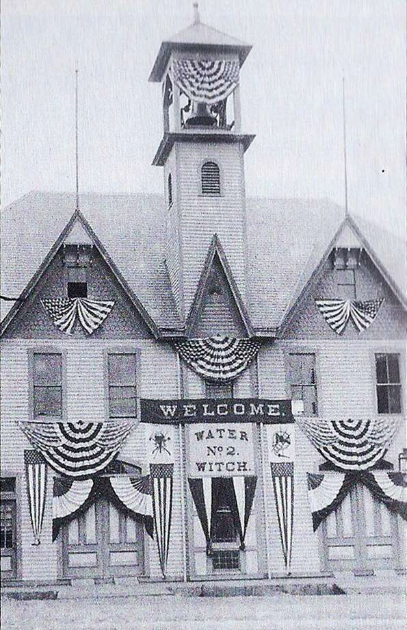 The firefighters of Water Witch Hose Co. No.2 dressed up their firehouse along an as yet unpaved Church Street in the New Milford village center in the very best patriotic buntings for July 4, 1900. The fire company was well into its fourth decade of service to the community at that time. This building, now called home by Ruth Chase Flowers, was to serve the New Milford firefighters for 60 more years into the 20th century before a modern edifice was constructed in 1960 along Grove Street (Route 67). Those who would like to loan or contribute a photo from any New Milford-area towns should bring it to the Greater New Milford Spectrum office at 45B Main St. If the photo is to be returned, please leave a phone number and mailing address. Photo: Courtesy Of Images Of America — New Milford / The News-Times Contributed