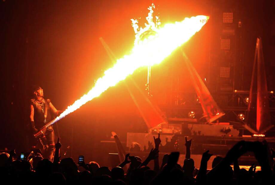 """Flames shoot out of Nikki Sixx' bass during the song, """"Shout at the Devil,"""" while performing with Motley Crue at the Matthew Knight Arena on July 22, 2015 in Eugene, Ore. (Genaro Molina/Los Angeles Times/TNS) Photo: Genaro Molina, MBR / McClatchy-Tribune News Service / Los Angeles Times"""