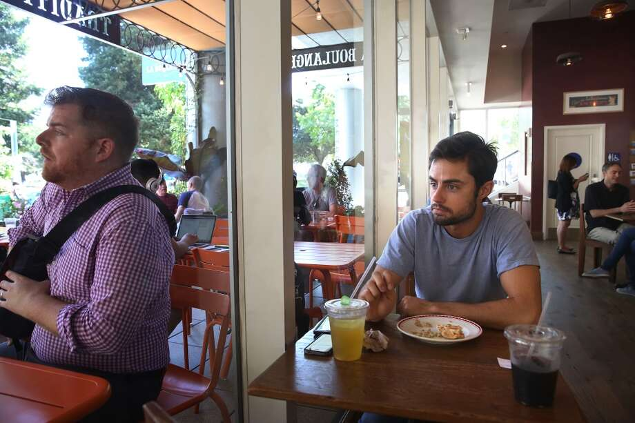 Troy Haught (right) visits La Boulange at Yerba Buena Gardens on Mission Street in San Francisco, Calif., about three times a week for breakfast and/or lunch for the past year and has a tuna sandwich on Thursday, August 27, 2015. Photo: The Chronicle