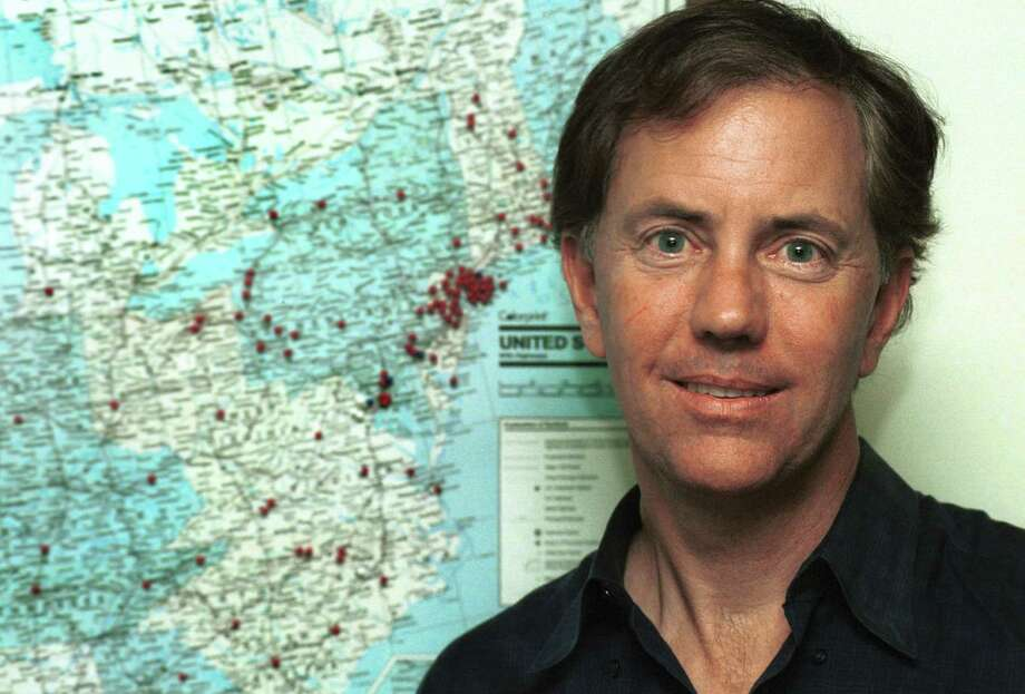 Entrepreneur and former gubernatorial candidate Ned Lamont in 2003, with a map in the background pinpointing schools served at the time by his Campus T elevideo. Photo: Dru Nadler / File Photo