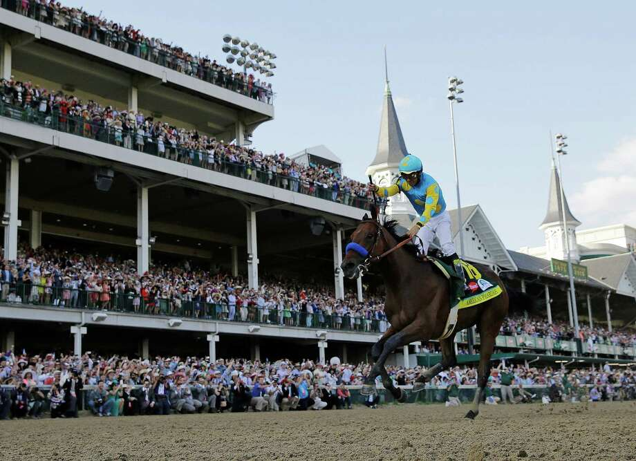 FILE - In this May 2, 2015, file photo, Victor Espinoza rides American Pharoah to victory in the 141st running of the Kentucky Derby horse race at Churchill Downs in Louisville, Ky. Churchill Downs plans to offer more premium seating with an $18 million project expected to be done in time for next year's Kentucky Derby. The Louisville track said Tuesday, Sept. 1, 2015, the project will modernize its Turf Club and other premium clubhouse areas. (AP Photo/David J. Phillip, File) ORG XMIT: NY165 Photo: David J. Phillip / AP