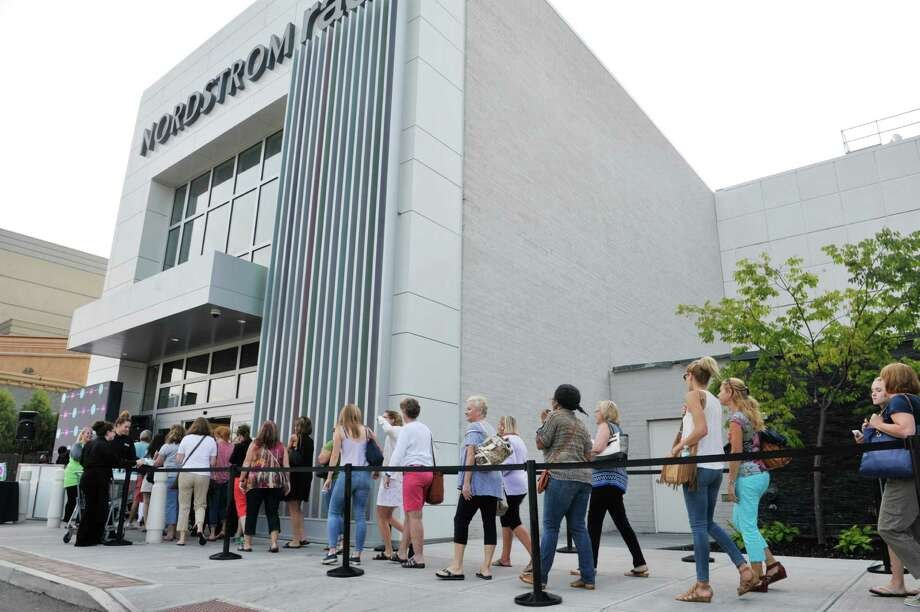 Shoppers make their way inside for the for the grand opening of Nordstrom Rack store at Colonie Center on Thursday, Sept. 3, 2015, in Colonie, N.Y.  (Paul Buckowski / Times Union) Photo: PAUL BUCKOWSKI / 00033223A