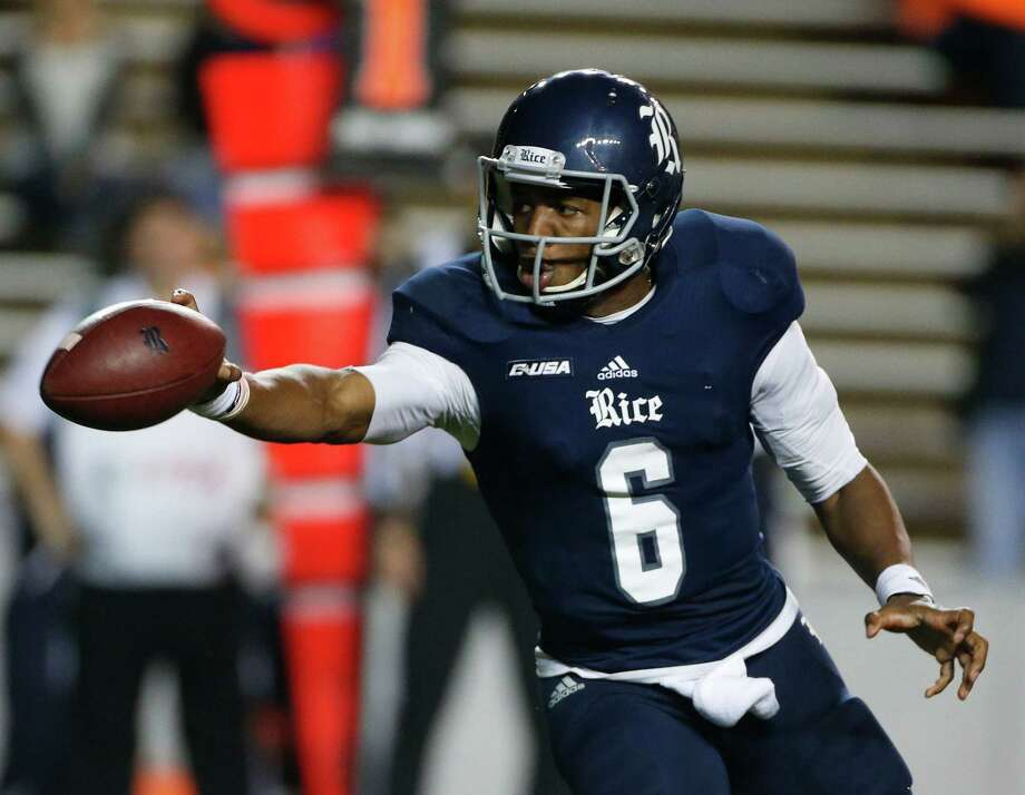 Rice Owls quarterback Driphus Jackson (6)tosses the ball  during the second half of a college NCAA football game at Rice Stadium, Friday, Nov. 21, 2014, in Houston.  ( Karen Warren / Houston Chronicle  ) Photo: Karen Warren, Staff / © 2014 Houston Chronicle