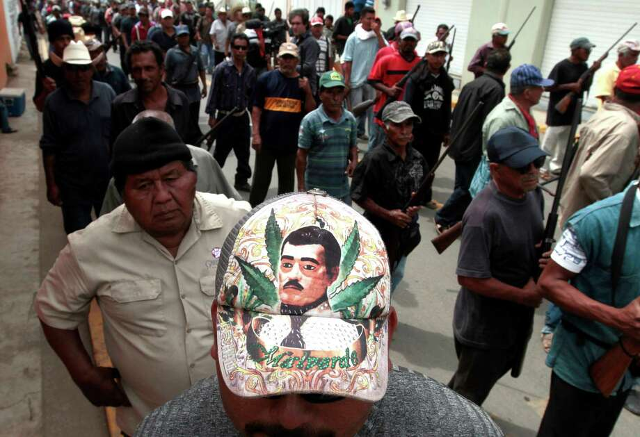 JESUS MALVERDENarcos-saint, in photosA community police member wearing a cap depicting Jesus Malverde --the saint of drug traffickers-- takes part in the March for Justice and Dignity, in Ayutla de los Libres, on March 2, 2013, in the southwestern State of Guerrero, Mexico.Hundreds of civilians armed with rifles, pistols and machetes decided to provide security for the communities of Guerrero, creating a vigilante force, saying gangs were committing robberies, kidnappings and murder. Guerrero, home to the Pacific resort town of Acapulco, has been one of the states hardest hit by Mexico's drug violence, which has left more than 70,000 people killed across the country since 2006.  Photo: AFP, Getty Images / 2013 AFP