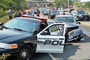 Schenectady officer hurt in crash - Photo