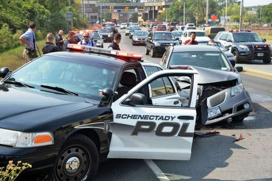 A Schenectady police officer was injured in a crash Thursday afternoon on Erie Boulevard. (John Carl D'Annibale / Times Union)