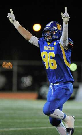 Queensbury's Keeghan O'Leary celebrates their 28-21 win over Cornwall as they clock winds down in their Class A football state semifinal on Friday, Nov. 21, 2014, at Dietz Stadium in Kingston, N.Y. (Cindy Schultz / Times Union) Photo: Cindy Schultz / 00029566A