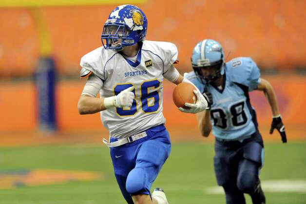 Queensbury's Keeghan O'Leary, left, gains yards during their Class A state football final against Indian River on Sunday Nov. 30, 2014, at the Carrier Dome in Syracuse, N.Y. (Cindy Schultz / Times Union) Photo: Cindy Schultz / 00029663A