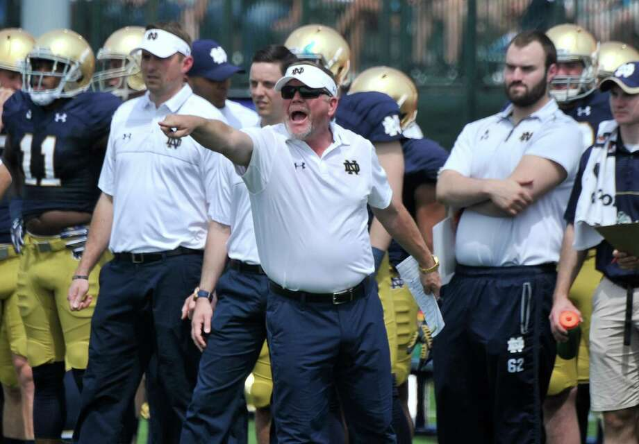 Notre Dame and coach Brian Kelly will host the Texas Longhorns in a matchup between two of the most successful college football programs in history. Photo: Joe Raymond /Associated Press / FR25092AP