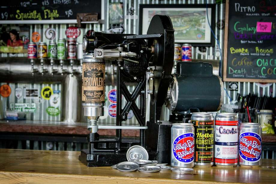 A new device marketed by craft beer canning pioneer Oskar Blues allows retailers to seal individual 32-ounce cans. The cans, Crowlers (can growlers), have run afoul of the Texas Alcoholic Beverage Commission. Photo: Courtesy Photo