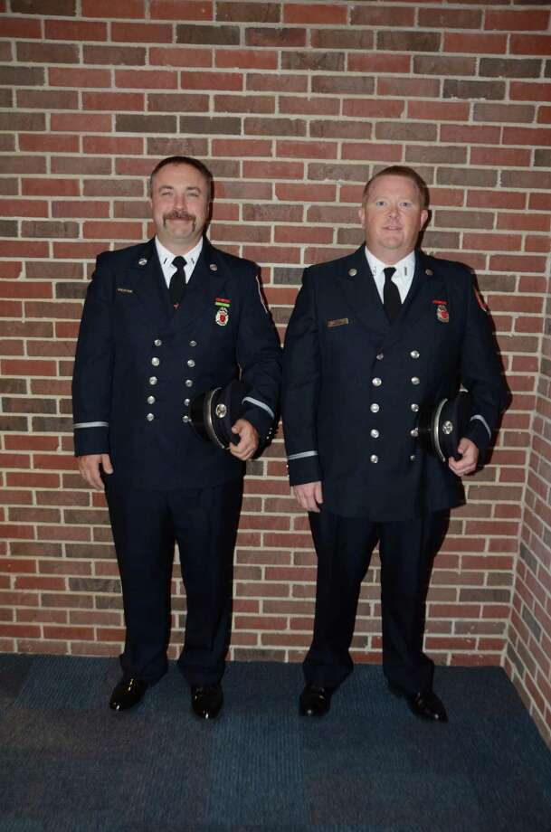 Eric Handau, left, and Tyler Bergemann during a promotion ceremony in Danbury Thursday morning. Photo: Contributed / Danbury Fire Department