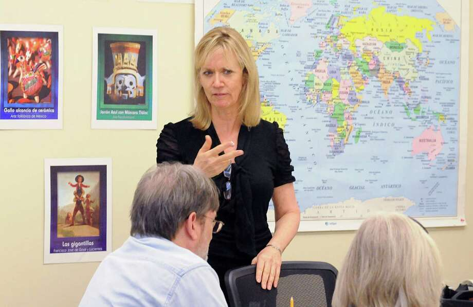 Professor Andrea Bacorn works with students in her Spanish class at Lone Star College-Montgomery. Bacorn wrote and helped produce a telenova, a Spanish soap opera, to help her students learn Spanish and immerse themselves in the culture. Photograph by David Hopper. Photo: David Hopper, Freelance / freelance