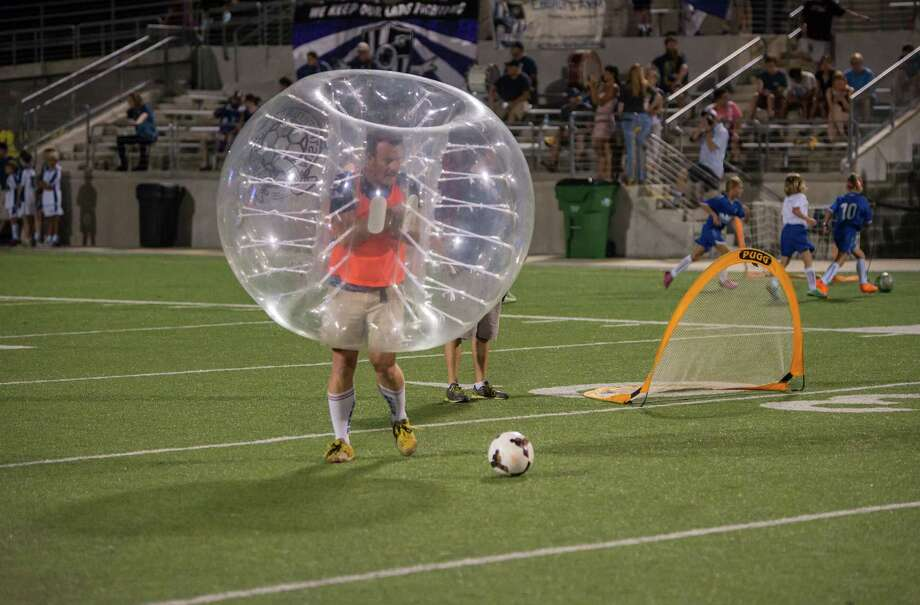 Mike Livermore lines up a kick during a bubble soccer match during halftime of an Austin Aztex game on Aug. 22 at Kelly Reeves Stadium in Austin. Photo: Joshua Trudell /For The Express-News