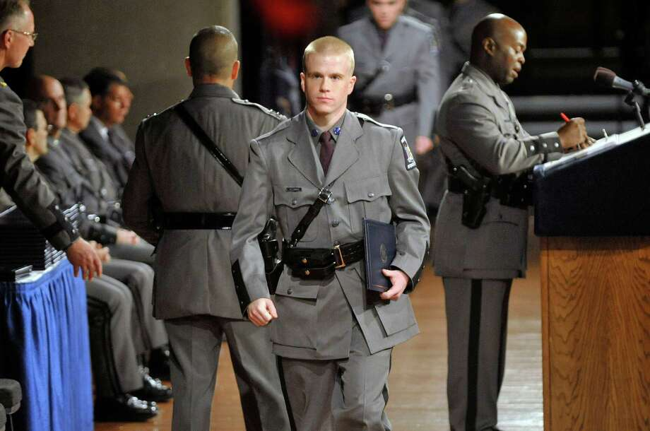 Graduating trooper Kevin Leibach from Troy walks off the stage after receiving his diploma during the 203rd session of the Basic School of the New York State Police Academy graduation ceremony on Thursday, Sept. 3, 2015, in Albany, N.Y.  (Paul Buckowski / Times Union) Photo: PAUL BUCKOWSKI / 00033152A