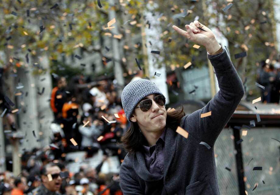 Tim Lincecum waves to fans while riding in the San Francisco Giants World Series Parade in San Francisco, Calif., Wednesday, October 31, 2012. Photo: Sarah Rice, Special To The Chronicle