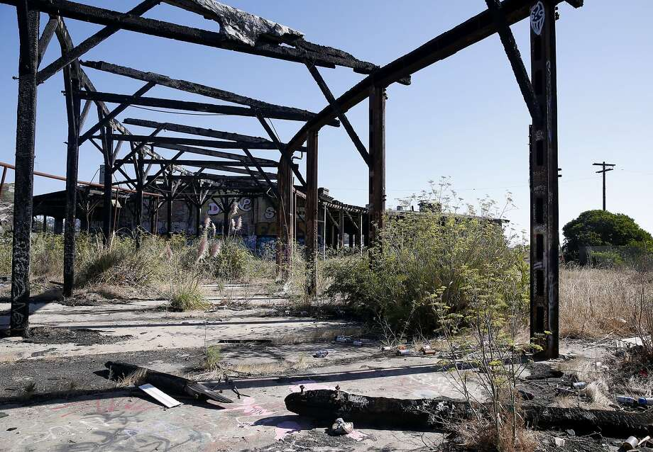 The Bayshore Roundhouse, which was once a hub on the old Southern Pacific railyard, sits abandoned and decaying on open space land between Bayshore Boulevard and Highway 101 in Brisbane, Calif. on Thursday, Sept. 3, 2015. The historic roundhouse will be restored as part of the Baylands mixed-use development project which is planned for the 660-acre site. Photo: Paul Chinn, The Chronicle