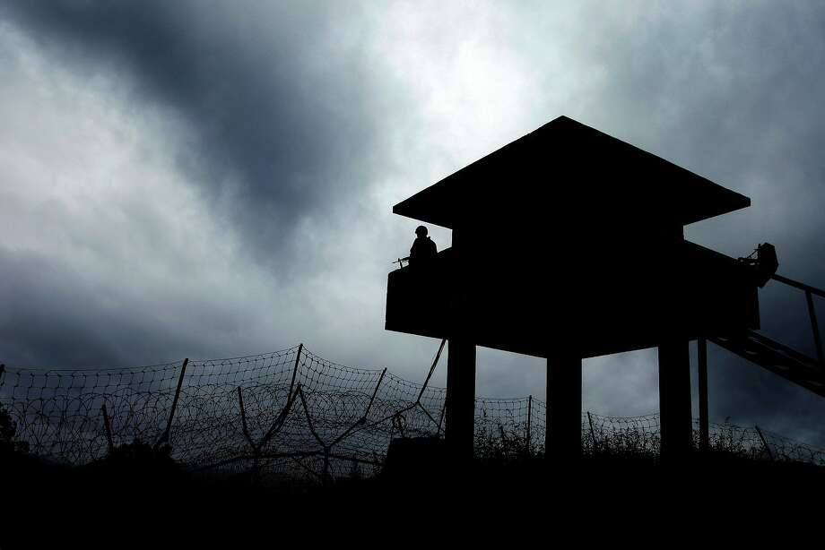 A South Korean military guard post rises above the barbed-wire fence of the Demilitarized Zone (DMZ). Photo: Yonhap, AFP / Getty Images
