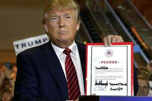 Trump signs GOP pledge, commits to back party nominee - Photo