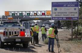 Members of the media are given a look at the new system during a test run, as CalTrans is preparing to implement the I-80 Smart Corridor project in late 2015. Seen along the west bound lanes of the freeway at University in Berkeley, Calif. on Thurs. September 3, 2015. When the system is up and running green arrows will indicate open lanes, yellow arrows will indicate a merge out of that lane and a red x will indicates a blocked lane.