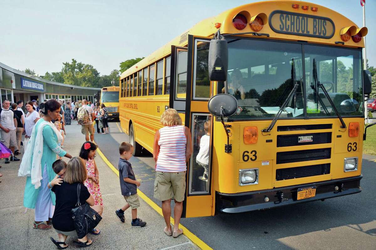New kindergarten students take school buses for a practice ride at Latham Ridge Elementary School Thursday Sept. 3. 2015 in Colonie, NY. (John Carl D'Annibale / Times Union)