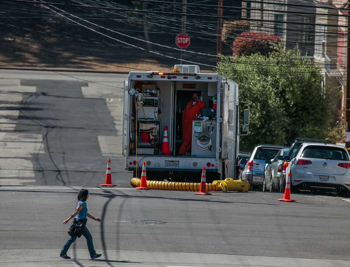 Public Utility Commission employee Francisco Lastra works inside the vehicle while a camera-carrying drone inspects a newly installed sewage line on Thursday, Sept. 3, 2015 in San Francisco.