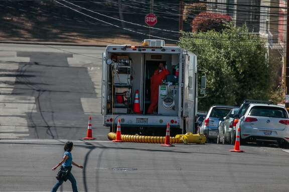 Public Utility Commission (PUC) employee Francisco Lastra works inside the vehicle while the camera-carrying drone inspects a newly installed sewage line below on Thursday, Sept. 3, 2015 in San Francisco, Calif.  The PUC has inspected more than 150 miles of sewage lines this year -- the most ever.