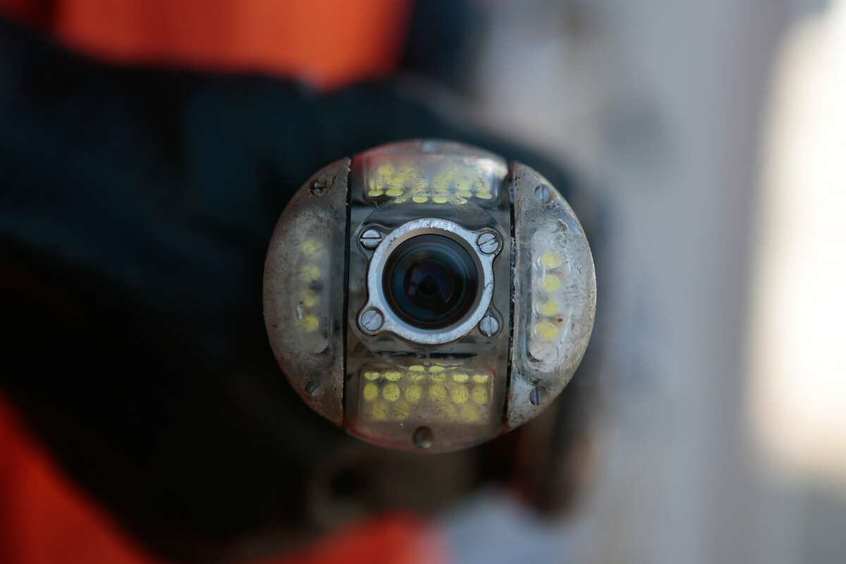 PUC employee Francisco Lastra holds one of the cameras used to inspect sewage lines.