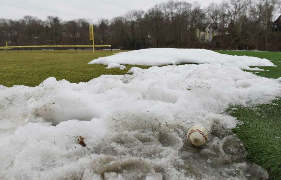 Snow was still covering a Greenwich baseball field last March Photo: Tyler Sizemore / Tyler Sizemore / Greenwich Time