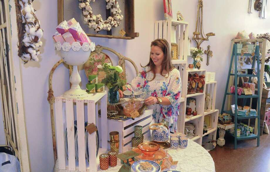 Owner Caroline Powell decorates with new merchandise in her Tumbleweeds and Notions gift shop, 8021 Research Forest Drive. Powell, of The Woodlands, opened her whimsical West Texas gift shop on August 31st. Photograph by David Hopper. Photo: David Hopper, Freelance / freelance