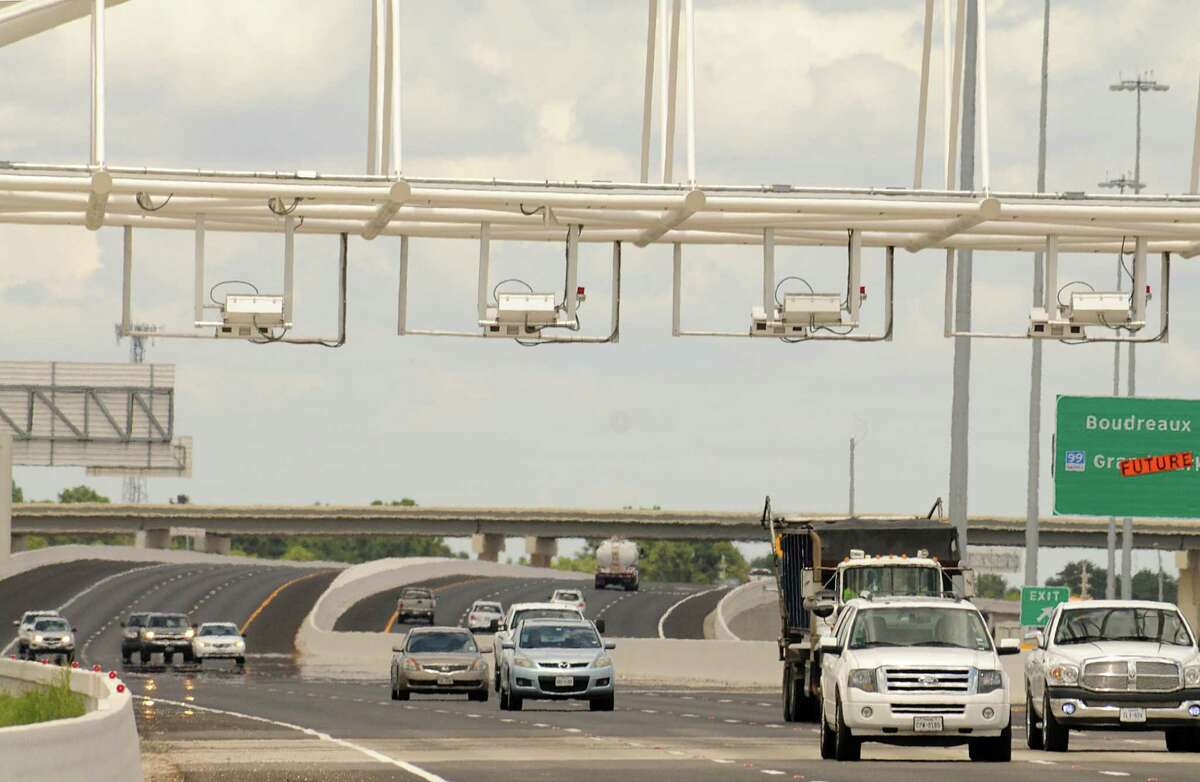 Drivers pass under the Toll Tag readers on the Tomball Tollwa in mid-2015.