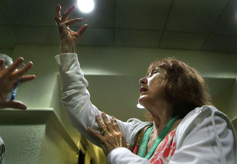 Cheryl Mackin recalls a near-death experience when she drowned, at the International Association of Near-Death Studies gathering, at Marriott Riverwalk on Thursday. Photo: Bob Owen /San Antonio Express-News / San Antonio Express-News