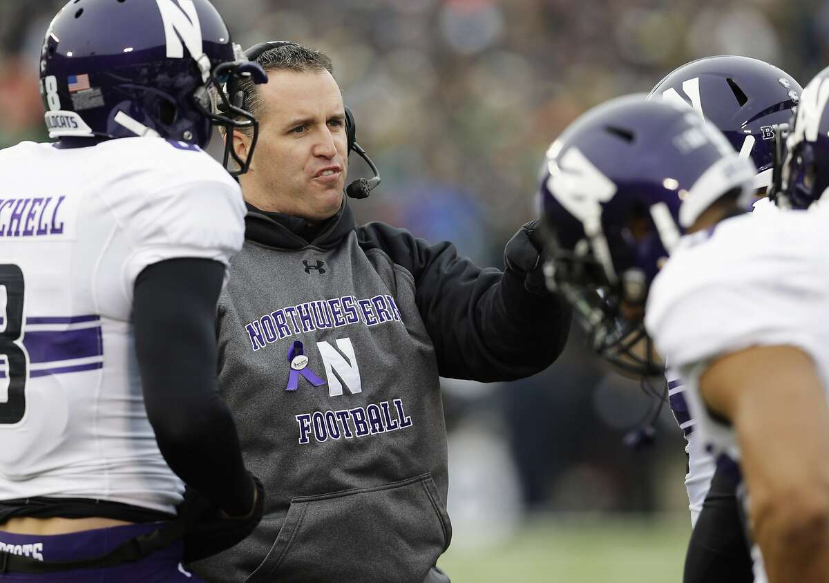 FILE - In this Nov. 15, 2014, file photo, Northwestern head coach Pat Fitzgerald talks to his team during an NCAA college football game against Notre Dame in South Bend. Fitzgerald is entering his 10th season leading his alma mater. Northwestern hosts Stanford on Sept. 5, 2015 to open their season. (AP Photo/Nam Y. Huh, File)