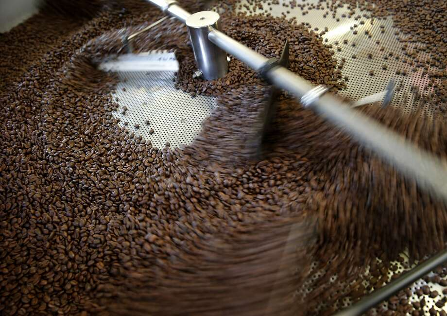 A coffee roaster at Equator Coffee cools off roasted beans at the company's 