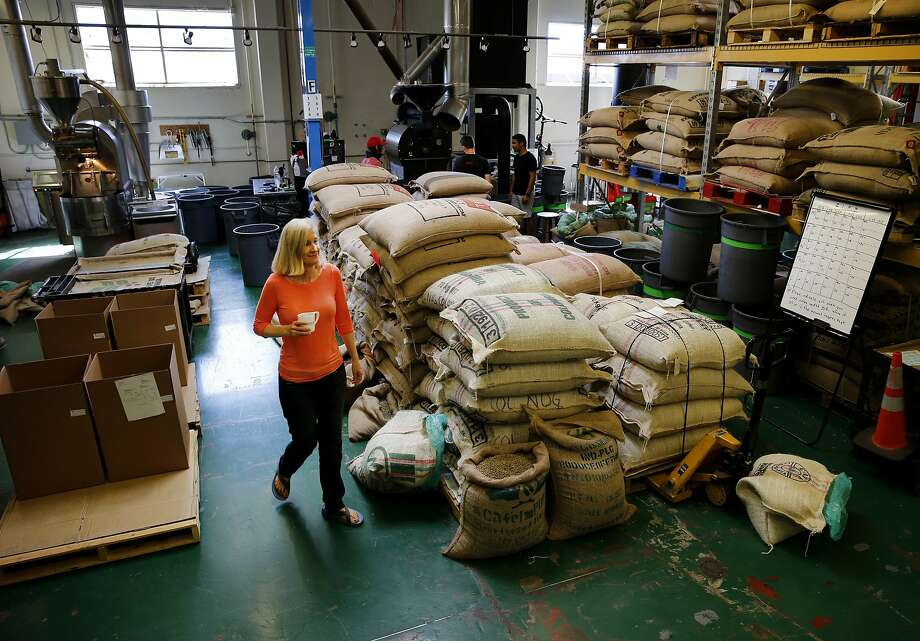 Equator Coffee co-founder Brooke McDonnell walks through the company's roasting plant in San Rafael. Equator purchases about one third of its coffee from Fair Trade USA certified coffee growers. Photo: Brant Ward, The Chronicle