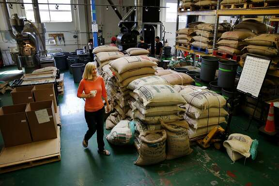 Equator Coffee co-founder Brooke McDonnell walks through the plant Thursday September 3, 2015. Equator Coffee in San Rafael, Calif. purchases about one third of their coffee from Fair Trade USA certified coffee growers, which owners believe keeps the global coffee industry viable through dips in the market.