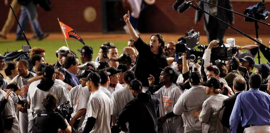 Winning pitcher, Tim Lincecum is lifted up on teammates shoulders as the Giants celebrate on the field after winning the final game of the World Series.The San Francisco Giants defeated the Texas Rangers 3-1 in Game 5 of the World Series at Rangers Ballpark in Arlington, Tx, on Monday, November 1, 2010.  150 Anniversary Maybe Photo: Carlos Avila Gonzalez / San Francisco Chronicle / ONLINE_NO