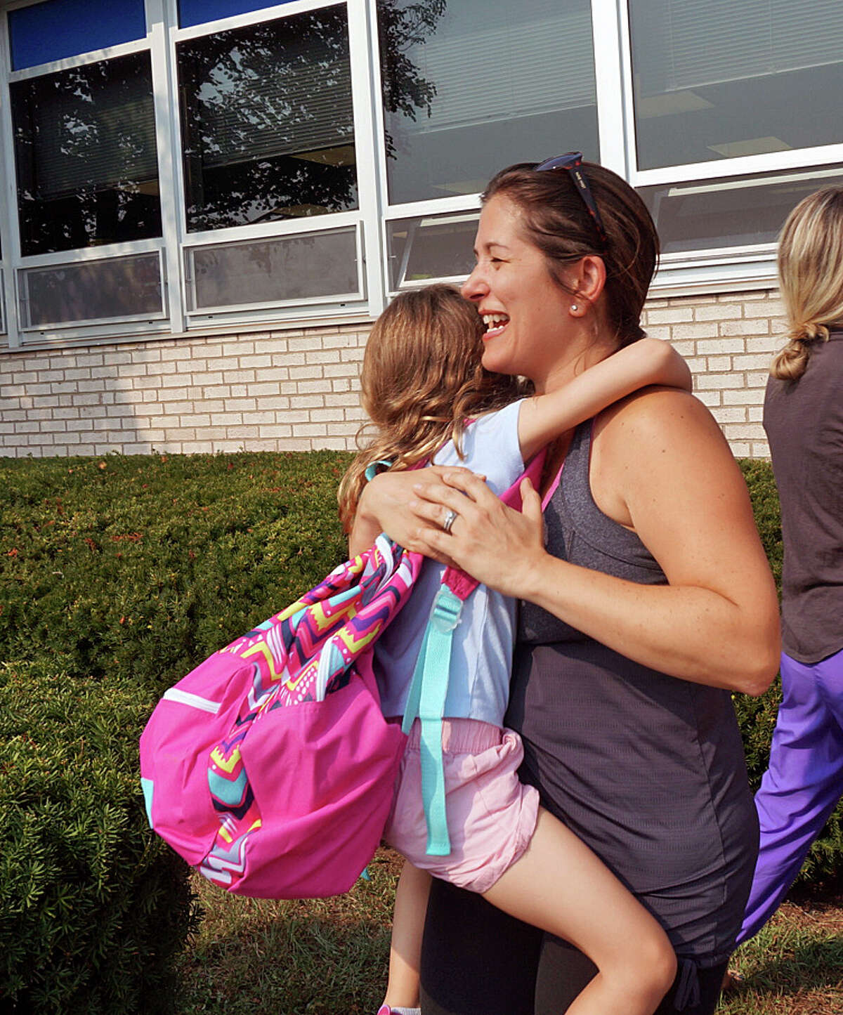 The hugs at the end of the first day at Sherman School were just as big as the ones at the start of the day Thursday.